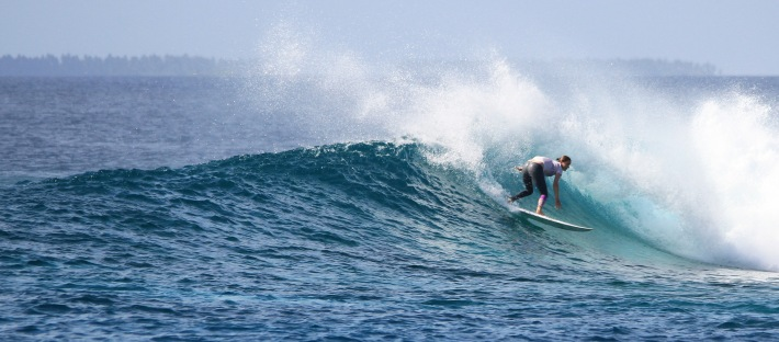 Stacey backhand in her surf leggings in the Maldives female surfer